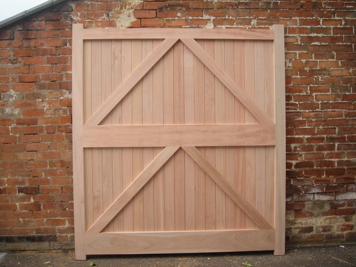 Farm style custom drive wood gates high quality wooden for Wood garage door manufacturers